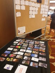 CCS image cards laid out for participants entering the room
